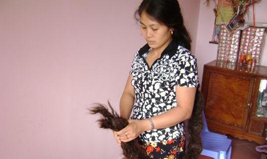 Kỳ lạ người phụ nữ có mái tóc hình rồng