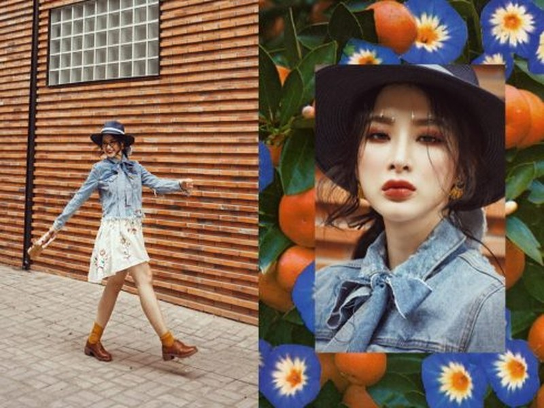 Tạm rời xa phong cách quyến rũ gần đây, Angela Phương Trinh làm người hâm mộ bất ngờ với thời trang xuống phố theo phong cách đồng quê. Chiếc váy hoa dịu dàng diện bên trong áo jean cổ nơ cách điệu. Giày bốt thấp màu nâu và mũ rộng vành là những phụ kiện giúp Angela chẳng khác gì một quý cô nhạc đồng quê đỏm dáng.