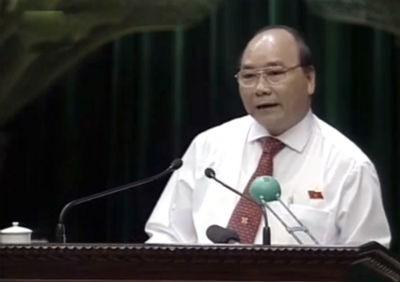 Phó Thủ tướng Chính phủ Nguyễn Xuân Phúc tại phiên chất vấn chiều qua - 14/6